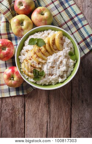 Rice With Caramelized Apples And Fresh Apples On Table. Vertical Top View