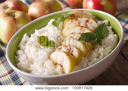 Healthy Dessert: Rice With Apples And Cinnamon Close Up. Horizontal.
