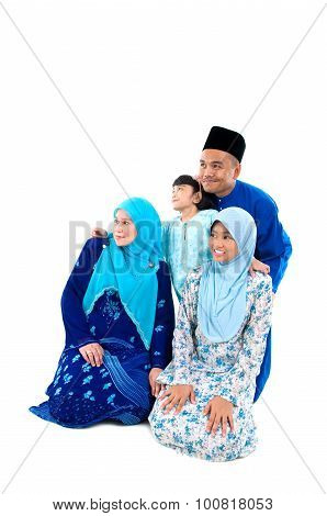 muslim family looking forward