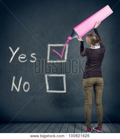young schoolgirl with yes or no choice, voting for yes