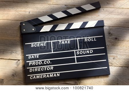 Film slate or movie clapper board on wood background