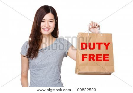 Asian Woman hold with shopping bag for showing phrase of duty free