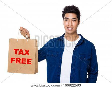 Man hold a shopping bag for showing phrase of tax free