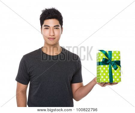 Asian young man hold with gift box