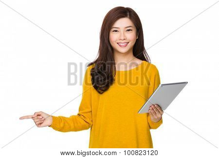 Woman use of the digital tablet and finger point up