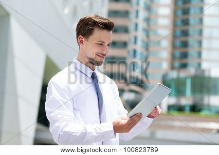 Caucasian young businessman read on the tablet pc