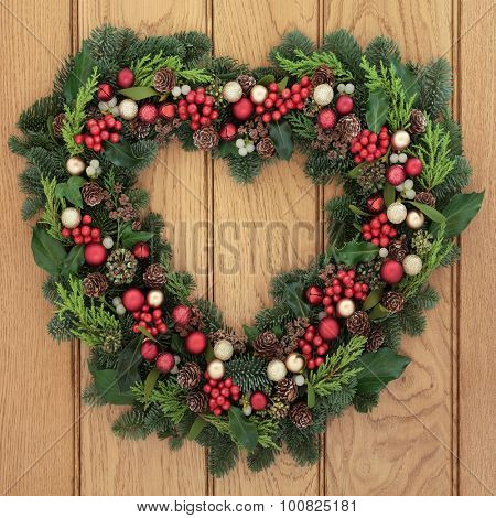 Christmas Heart Wreath.Christmas Heart Shaped Wreath With Red Bauble Decorations Holly Mistletoe And Greenery Over Oak F Poster