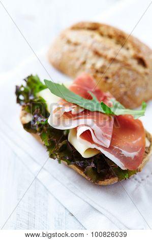 Bread roll with serrano ham and arugula