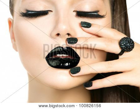 Beautiful Fashion Model woman with Long Lushes and Black make up isolated on white. Fashion Trendy Caviar Black Manicure. Nail Art. Dark Lipstick and Nail Polish. Vogue style