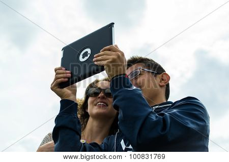 Tourists Taking A Selfie With Apple Ipad