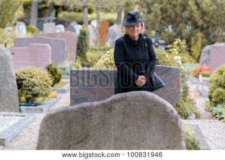 Senior Lady In Mourning At A Graveside