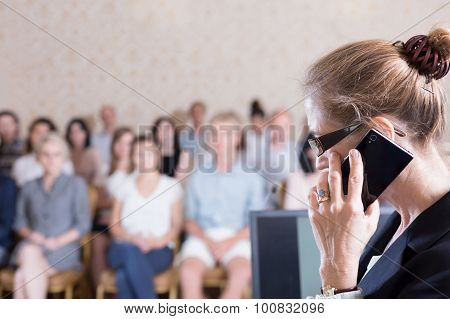 Professor Talking On Cellphone