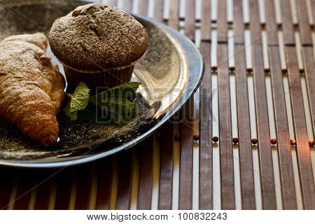 Delicious Muffin And Croissant On Plate