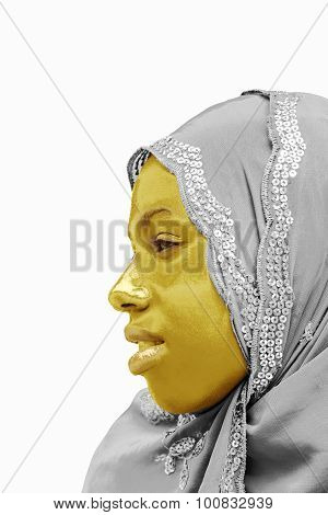 Golden and silvery portrait of a Muslim teenager, isolated