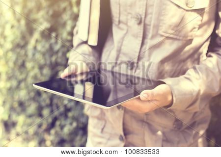 Man Using Laptop And Keeping Book, Vintage Photo Effect