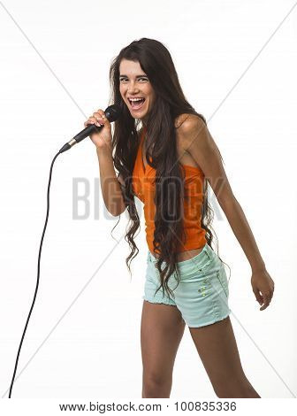 Mischievous woman in orange shirt with microphone.