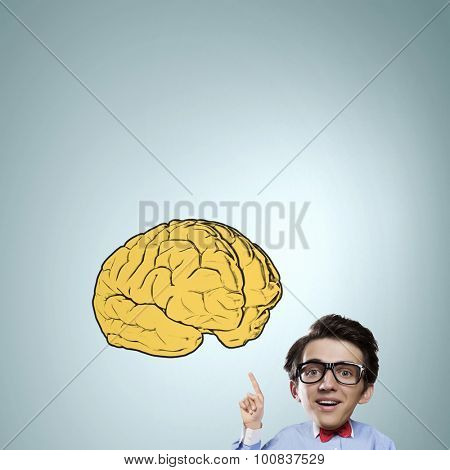 Idea concept with businessman with big head pointing at big  brain