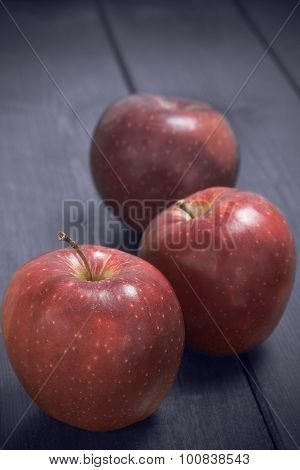 Red Apples On A Rustic Background.