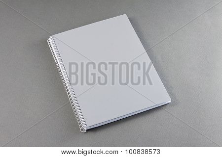 Gray Notebook On A Gray Background.