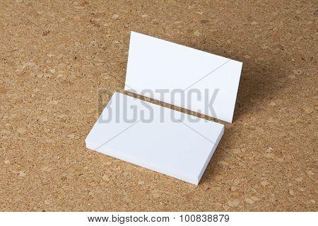 Blank Business Cards On Corkboard Background