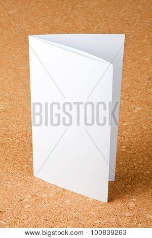 Blank Folding One Page Booklet On Corkboard Background