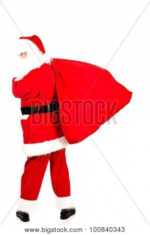 Full length portrait of a Santa Claus with a bag full of gifts