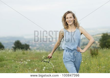 beautiful young woman posing on a meadow.