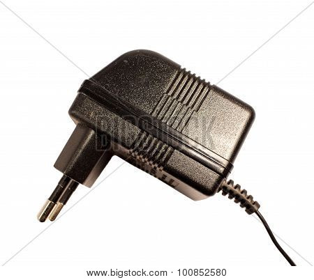 Big black AC/DC adapter on white background.