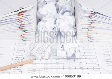 Bankruptcy Of House And Paper Ball With Bottom Of Pencil