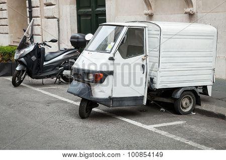 White Piaggio Ape 50 Van Stands Parked