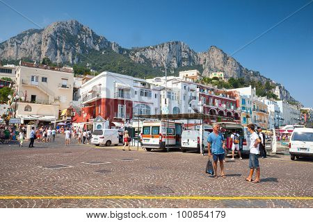 Port Of Capri With Tourists, Cars, Building Facades
