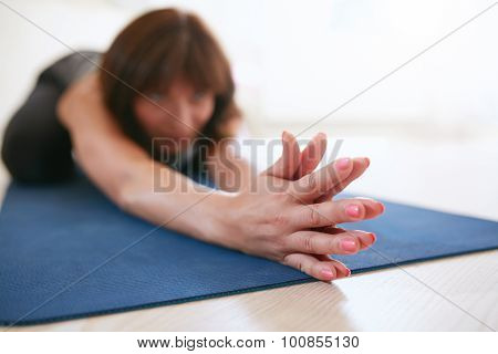 Woman Doing Stretching Workout On Yoga Mat