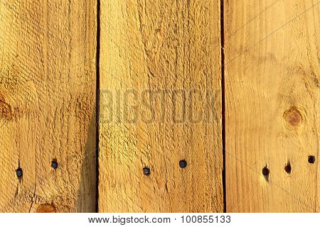 Wooden shipping pallete texture with nails in it