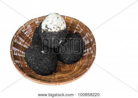 Salted eggs in rattan basket, isolated on white background