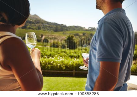Couple At Winery With Glass Of White Wine