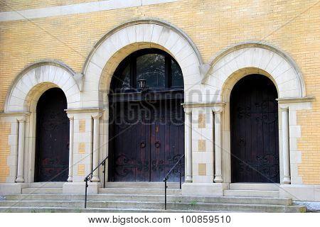Three heavy wood doors in old church