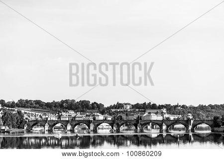 Karlov or charles bridge river Vltava in Prague black and white
