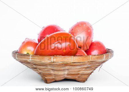 Fresh mini tomato in wooden rattan basket