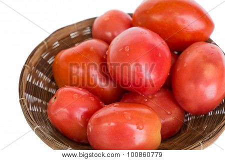 Close-up fresh mini tomato in wooden rattan basket