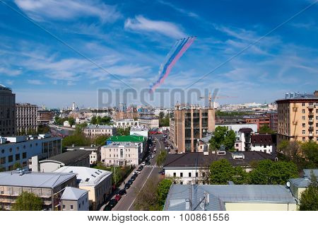 MOSCOW - MAY 9, 2015: Aircrafts make tricolor smoke during military parade on anniversary of Victory in World War II