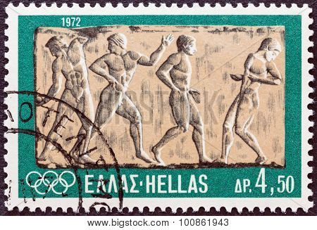GREECE - CIRCA 1972: A stamp printed in Greece shows Ball game (bas-relief)