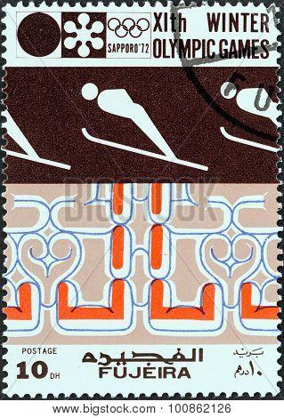 FUJAIRAH EMIRATE - CIRCA 1972: Stamp shows shows Ski jumping