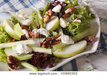 Fresh Waldorf Salad Close-up On A Plate On The Table. Horizontal