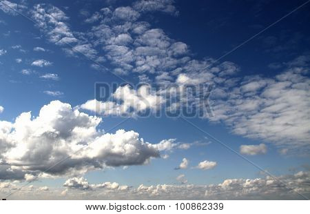 Stratus, cirrus and columnar clouds in the same time on blue sky