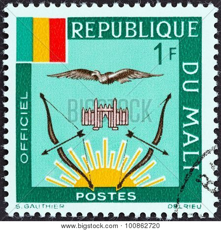 MALI - CIRCA 1964: A stamp printed in Mali shows Mali Flag and Emblems