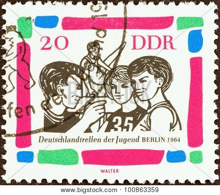 GERMAN DEMOCRATIC REPUBLIC - CIRCA 1964: A stamp printed in Germany shows Young gymnasts