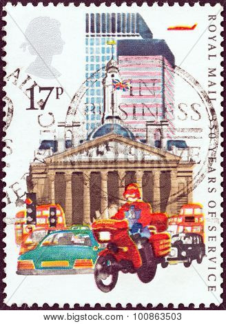 UNITED KINGDOM - CIRCA 1983: Stamp shows Datapost Motorcyclist, City of London