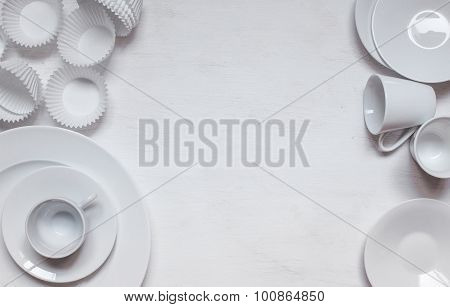 White Ceramic Cups And Plates With Cupcakes Form
