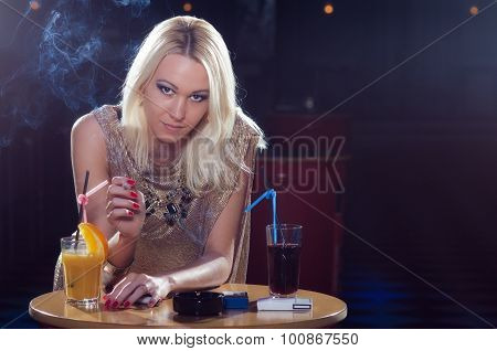 Beautiful Elegant Lady Sitting Alone In The Night Club