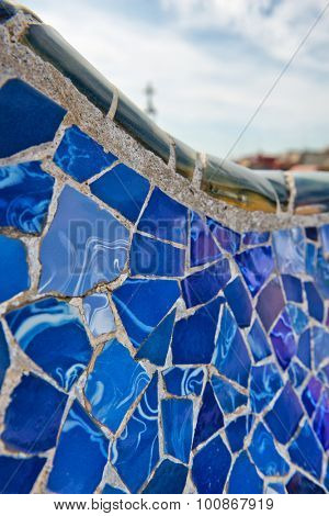 BARCELONA, SPAIN - MAY 02: Detail of bright blue ceramic mosaics on the curving wall on the main terrace, Parc Guell, Barcelona, Spain, May 02, 2015.
